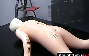 Sexy gay boys try kinky sex with a blow-up doll on table