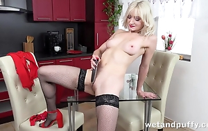 Sexy flaxen-haired in stockings pleases herself with dildo