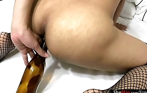 Thai tranny fucks beer decanter and deepthroats massive dick